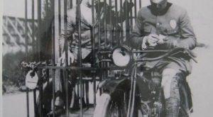 Old Harley Davidson police motorcycle and mobile booking center