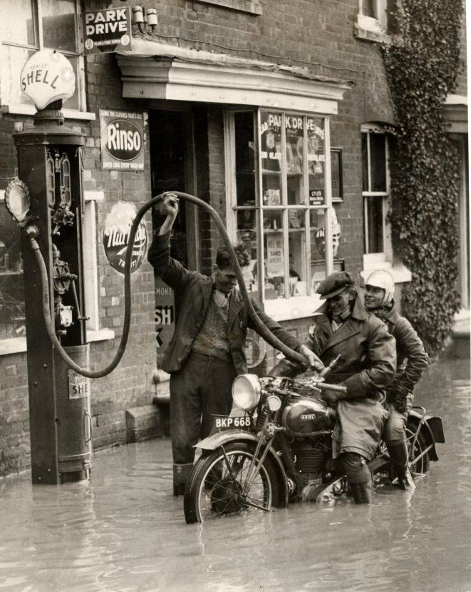 Shell, England 1935 | flood | adventure | motorcycle | fill up | vintage…