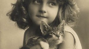 Well, yeah // 43 Vintage Photographs That Prove Cats Are A Girl's Best Friend